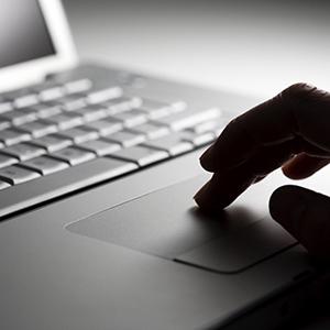Fingers on a laptop keyboard
